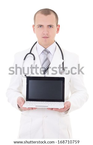 young male doctor showing laptop with copy space isolated on white background - stock photo