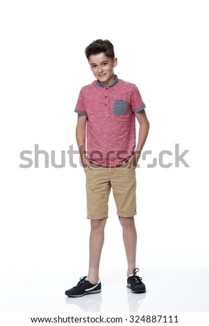 Young male dressed in casual clothing with a white background. he is looking at the camera and smiling.  - stock photo