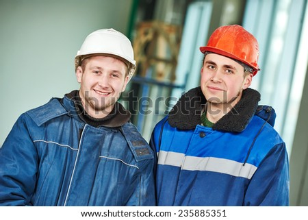 young male engeneers workers foreman at a indoors building site - stock photo