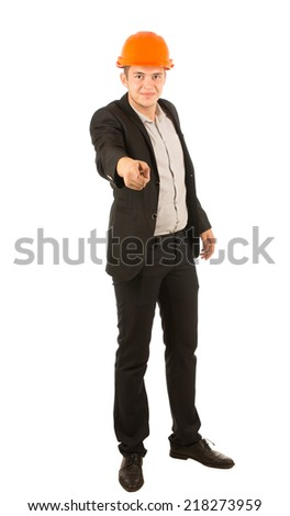 Young Male Engineer in Black Attire and Orange Helmet Pointing and Looking at Camera. Isolated on White Background. - stock photo