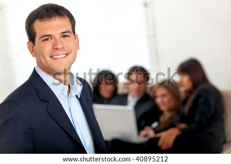 Young male executive smiling at the office