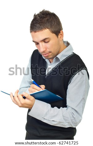 Young male executive taking notes in his personal agenda isolated on white background
