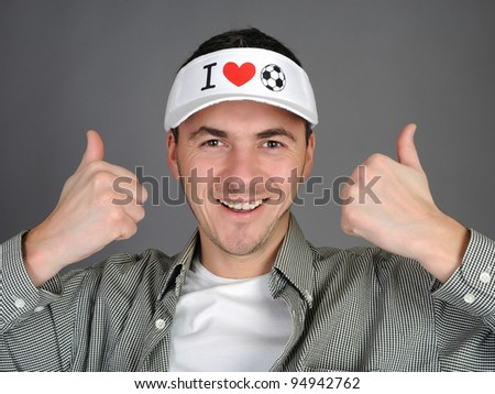 Young male football fan smiling and happy - stock photo