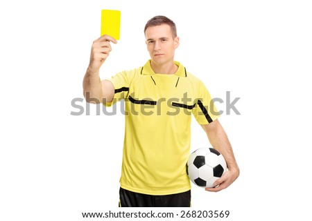 Young male football referee holding a ball and showing a yellow card isolated on white background - stock photo