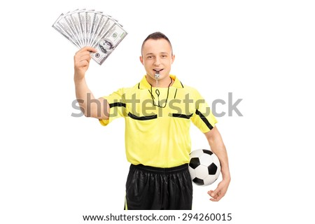 Young male football referee holding a stack of money and looking at the camera isolated on white background - stock photo