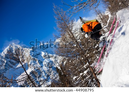 Young male freeride skier goes downhill in powder snow Mont Blanc Courmayeur Italy - stock photo