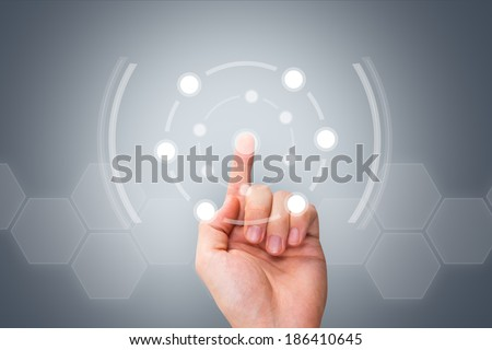 Young male hand touching and pressing modern buttons on digital screen interface on virtual background. - stock photo