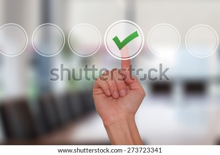 Young male hand touching, pressing modern button and ticking check box out of empty boxes on digital screen interface. Isolated on office. Business technology concept. Stock Image - stock photo