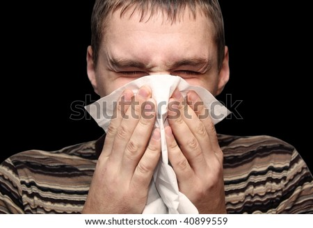 Young male having a cold or allergy - stock photo