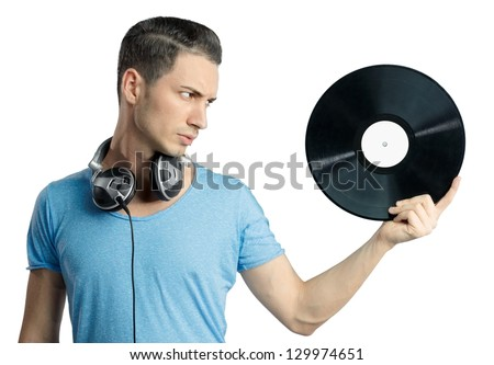 Young male having a serious expression while holding black vinyl in hand. Musical notes on gradient background.