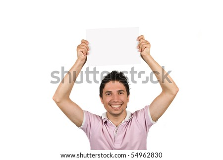 Young male holding a blank page over his head,smiling and looking at you isolated on white background - stock photo