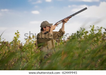 Young male hunter aiming the hunt during a hunting party