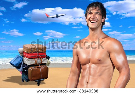 Young male model on the beach with suitcases and airplane on background - stock photo