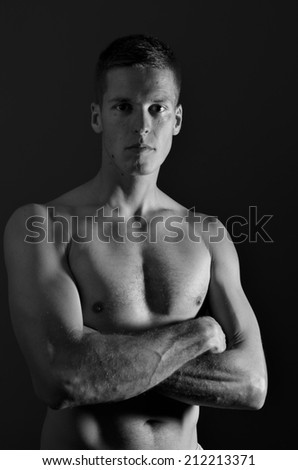 Young male model posing with a bare chest