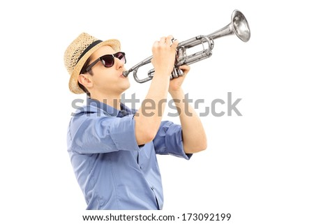Young male musician playing trumpet isolated on white background - stock photo