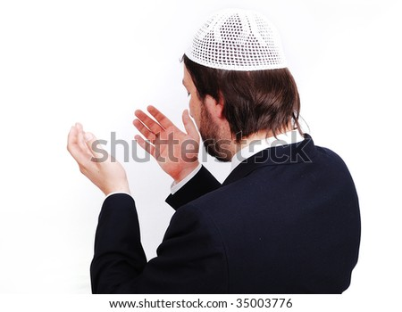 Young male muslim is praying and asking God - stock photo