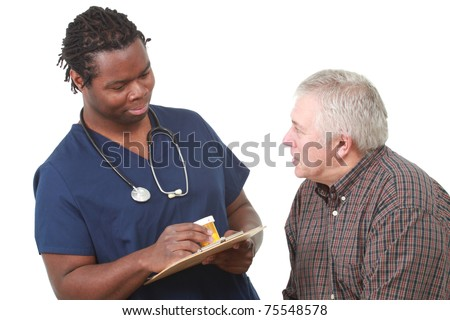 Young male nurse talks about medication with an older patient - stock photo