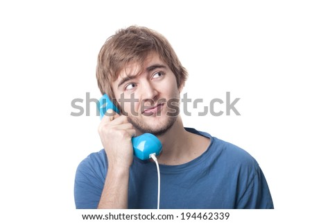 Young male on telephone looking at imaginary information text of communications contract.  - stock photo