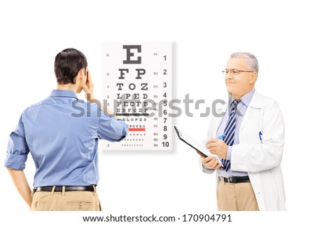 Young male patient taking eyesight test and an optician holding a clipboard, isolated on white background - stock photo