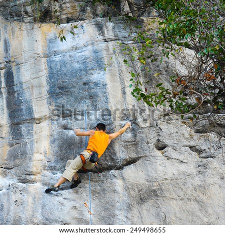 Young male rock climber, Krabi, Thailand - stock photo