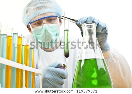 Young male scientist in laboratory - stock photo