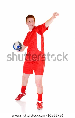 Young male soccer, football player, studio shot, reflective surface