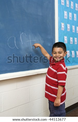 Young male student in front of blackboard with 'art' written on it. Vertically framed shot. - stock photo