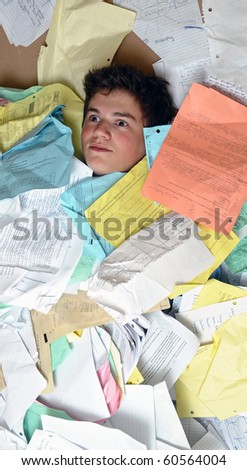 Young male student is overwhelmed by way too many homework assignments. - stock photo