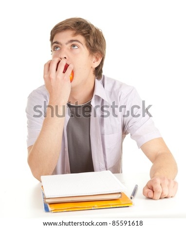 young male student with books and apple,white background, series