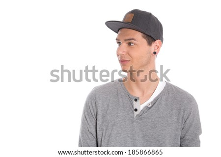 Young male student with cap looking sideways isolated on white background.  - stock photo