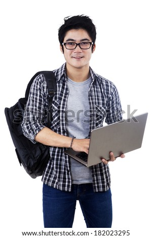 Young male student with laptop. isolated on white background - stock photo