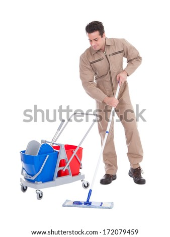 Young Male Sweeper Cleaning Floor On White Background - stock photo
