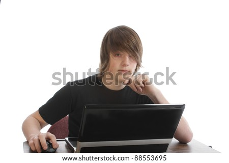 Young male teenager with laptop - stock photo