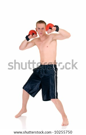 Young male thai boxer, studio shot, intense expression on face