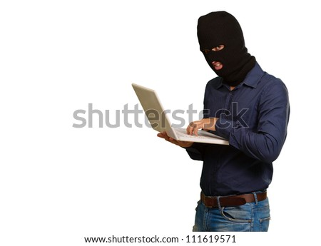 young male thief holding laptop isolated on white background