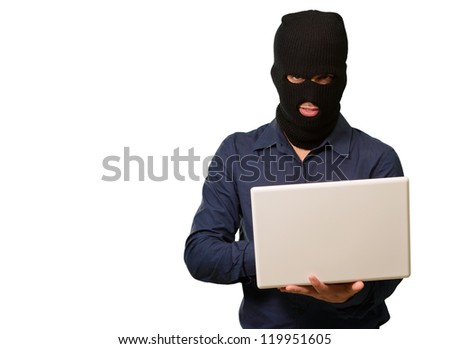 young male thief holding laptop isolated on white background - stock photo