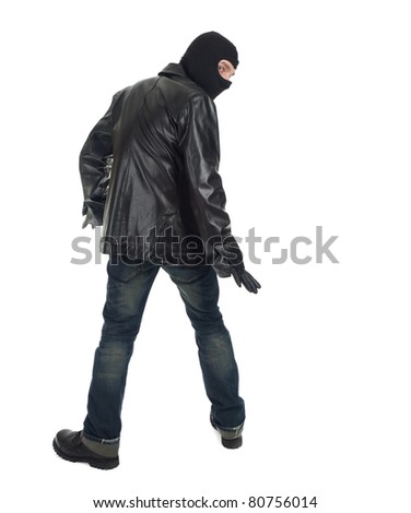 young male thief in balaclava and black leather jacket - stock photo