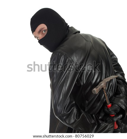 young male thief in balaclava and black leather jacket with hammer - stock photo