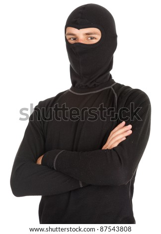 young male thief in balaclava with crossed arms, white background