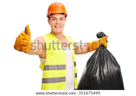 Young male waste collector holding a trash bag and giving a thumb up isolated on white background - stock photo