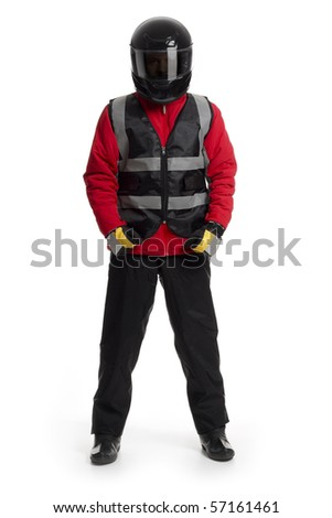 Young male wearing motorcycle suit and helmet. - stock photo