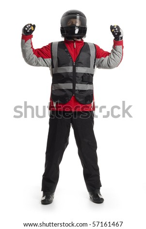 Young male wearing motorcycle suit and helmet, cheering - stock photo