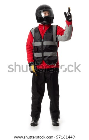 Young male wearing motorcycle suit and helmet., pointing up. - stock photo