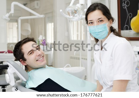 Young male with open mouth during oral checkup at the dentist - stock photo