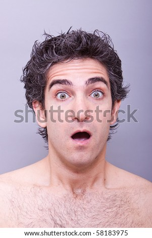 Young male with surprised or shocked facial expression - stock photo