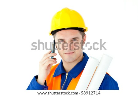 Young male worker wearing helmet against white background