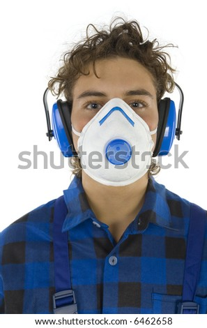 Young male worker with dust mask and hearing protectors. Looking at camera. White background - stock photo