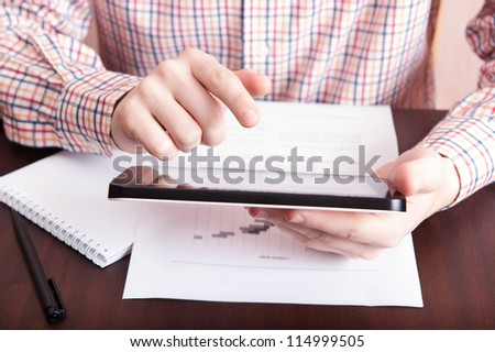 Young male working with tablet computer - stock photo