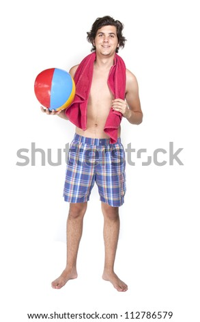 Young malewith towel and beach ball on white background