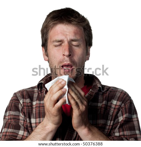 Young man about to sneeze - stock photo